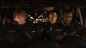 Eric (Gregory Gadebois), Virginie (Virginie Efira) et Aristide (Omar Sy) en mission.